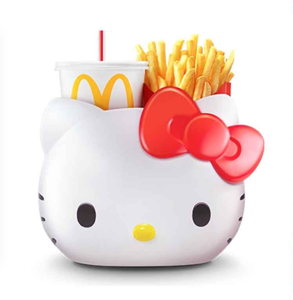 picture of a hello kitty carrier with mcdonalds drink and fries inside